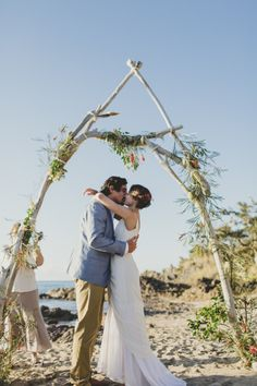 Beautiful DIY driftwood arbour, decorated with native Australian flowers