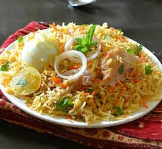 Mughlai Biryani, an Indian dish adapted to many regions of India in a variety of ways with different combination of spices ,keeping basmati rice and mutton,lamb or chicken as the meat item,plenty of onions fried to perfect gold is essential,and in clarified butter,saffron ,rose water,dried plums or apricots are added ,sometimes boiled eggs are added as garnish ,its eaten on special occasions.