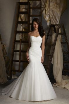 Top 10 Wedding Dress Designs {Wedding Connexion, Johannesburg} | Confetti Daydreams - Asymmetrical draped netting Mori Lee 5108 wedding dress (Cost: ZAR11,000) ♥ #WeddingDress #WeddingGowns ♥  ♥  ♥ LIKE US ON FB: www.facebook.com/... ♥  ♥  ♥