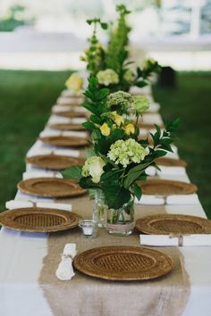 I like the burlap, white napkins with utensils, and the greenery. I'd add yellow flowers - roses?