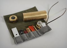 Life is Precious Survival Kit - includes a compass, pen knife, fishing wire, and more in a sharp looking and compact golden canister.