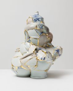 Shattered Porcelain Fragments Fused With Gold by Artist Yeesookyung