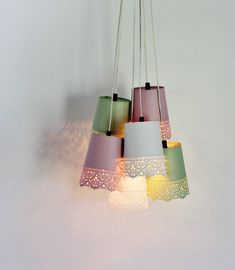 6 metal garden planters have been upcycled into a gorgeous chandelier which adds plenty of charm and style to any space. The lace design of the planters make them perfect for lamp shades! Romantic, pretty and a little bit country, this chandelier is sure to please! Our lights have been