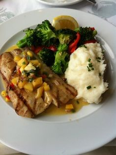 Mahi Mahi topped with mango salsa served with garlic mashed potatoes and vegetables