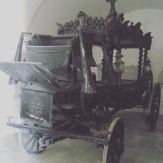 The local #cemetary had a small church where they displayed two old horse drawn #hearse.