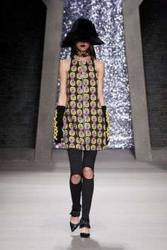 Ashley Williams - Fall 2015 Ready-to-Wear - Look 5 of 22: This collection shows the begginings of grunge in the late 1980's and early 1990's. This look shows influences from the 90's because of the graphic, colorful print on the dress with an exposed zipper. 3/2/15