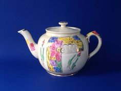 A personal favorite from my Etsy shop https://www.etsy.com/ca/listing/522749804/sadler-hand-painted-teapot-blue-pink