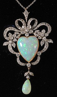 Edwardian platinum and gold heart shaped opal and diamond pendant 1910c