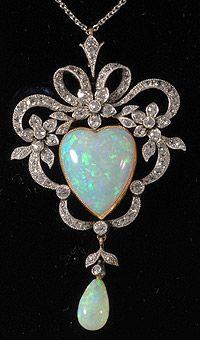 Edwardian platinum and gold heart shaped opal and diamond pendant 1910c