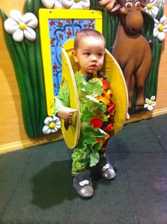 Taco toddler costume. We rolled with the theme. Burrito first year. Taco second year