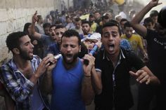 Mourners carry the bodies of the four Palestinian children from the Baker family, whom medics said were killed by a shell fired by an Israeli naval gunboat, during their funeral in Gaza City July 16, 2014.