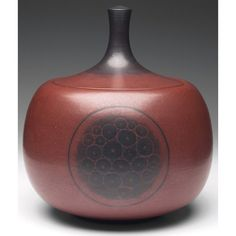 "Exceptional Harrison McIntosh covered vessel, large form covered in a brown matte glaze with black designs, signed, paper label, 7.5""w x 9""h"