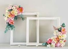 Paper flowers on an empty picture frame  Lauren B Montana
