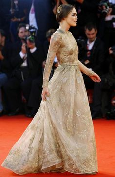 Keira Knightley walks on the red carpet at the premiere of A Dangerous Method, 68th Venice Film Festival. Dress by Valentino.