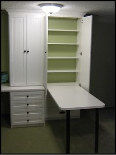 I could use this in my laundry room! Drop down folding table, put away when done, shelves to store laundry detergent, bleach, fabric softener, etc. All neatly tucked away.