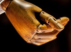 the warm golden glow of light reflected from an old worn mannikin hand. Cool Stuff, Wooden People, Steampunk, Vintage Mannequin, Marionette, Hold My Hand, Pinocchio, Wooden Hand, Brown Dress