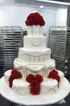 White wedding cake red roses