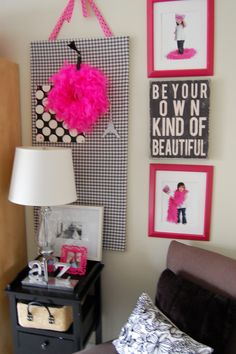 pretty craft room / office, decorated with bright pops of pink, and fun black and white patterns