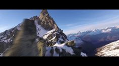 Guy risks his racing drone flying up a mountain. Gets rewarded with some beautiful footage