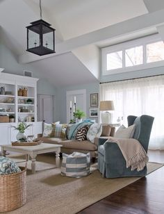 This is amazing example of a cottage design. This space with it's open space, mixed patterns and furniture feels very laid back, and personal. This room almost has it's own personality.