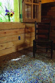 This blog has a bunch of recycled decor...but I totally want to do this!  A whole floor done with bottle caps!