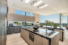 HGTV loves this contemporary kitchen with two large islands, an open floor plan and lots of natural light. Open Concept Kitchen, Open Plan Kitchen, Kitchen Dining, Dining Room, Kitchen Ideas, Double Island Kitchen, Kitchen Islands, Clerestory Windows, Kitchen And Bath Design
