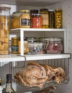 Storing food at home IKEA VARIERA white coated steel shelf insert and OBSERVATÖR metal clip-on basket are no-drill solutions that create more pantry shelving space for jams, jars, and bottles of different sizes. Ikea Kitchen Storage, Kitchen Cupboards, Kitchen Armoire, Cabinets, Ikea Variera, Bread Storage, Basket Storage, Door Storage, Storage Shelves