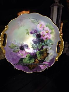Limoges handled bowl. WG & Co Limoges green ware mark circa 1920.   No artist signature or studio mark. Very high quality art work of blackberries and open pink roses.