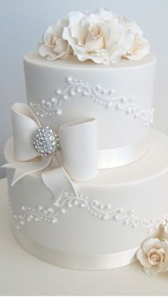 Wedding Cake with roses and piping. Love the details of the bow.