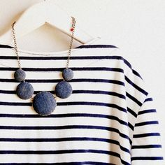 striped blouse and blue necklace