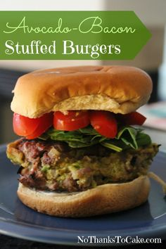 Avocado-Bacon Stuffed Burgers recipe with tomatoes, spinach, and Laughing Cow