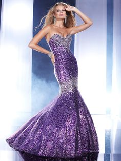 Dramatic tulle/sequins long prom pageant dress Panoply 14459. Striking mermaid silhouette igniting sensuality and drama to the pageant event. A heavily beaded strapless sweetheart neckline is just the beginning of the most spectacular dress sparkling all the way until the mermaid skirt brushes the floor length. When the fitted bodice shifts into the skirt, heavily beaded embellishments add extra light to the stage. Available in Red and Purple. Be the spotlight's preference completing this…