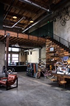 A new community-focussed bike shop and cafe has opened in Los Angeles' Art District – called The Wheelhouse. The premise of The Wheelhouse, was to combine the heritage of cycling, along with the ever- Design Garage, Design Loft, Modern House Design, Industrial Interior Design, Industrial Living, Industrial Interiors, Urban Industrial, Industrial Apartment, Industrial Style