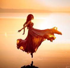 Image via We Heart It https://weheartit.com/entry/173581735 #beautiful #bright #dance #dress #long #ocean #sea #shine #sunrise #sunset #sunshine #water #woman