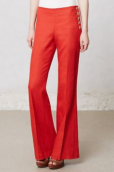 Orange-red trousers with back welt pockets and side buttons
