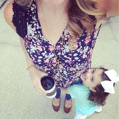 @jenblount sports her Stitch Fix floral blouse out & about with her little one.