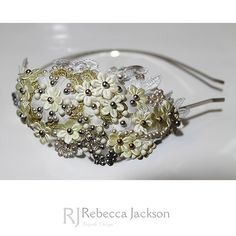 Rebecca Jackson 'Emily' Bespoke Bridal Tiara   Small satin ivory flowers are expertly laid onto gold lace applique and hand sewn to create this beautiful design. Swarovski Pearls, in ivory, silver, gold and matt ivory are delicately intertwined between the flowers by hand beading to create this