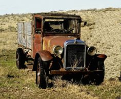 An abandoned Graham Brothers truck rusts away in a pasture