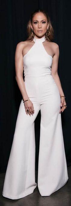 Jennifer Lopez's American Idol Vatanika Flared Leg White Halter Neck Jumpsuit J Lo Fashion, Daily Fashion, Fashion News, Fashion Outfits, White Fashion, Ladies Fashion, Jennifer Lopez, American Idol, Jumpsuit Elegante