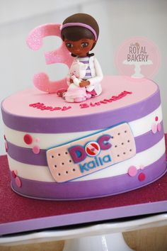 Doc McStuffins cake with fondant Doc and Lambie figures.