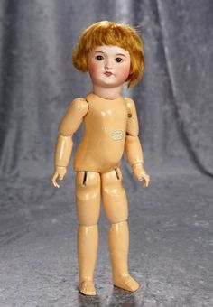 """15"""" French bisque bebe, 301, Unis France with original boutique label from Au Nain Bleu~~ Marks: Unis France 71 149 301 (head) Bebe Vrai Modele (body label) Au Nain Bleu Paris (paper label on body). Generally excellent. SFBJ, circa 1915, the doll was sold by the prestigious Parisian doll shop of Au Nain Bleu."""