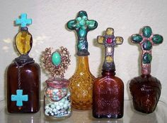 Bottles created with vintage jewelry, beads, and chandelier crystals. Made by Tammy Weeden