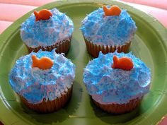 pool party cupcakes--- it would be cute to use sweet flavored goldfish; like cupcake or smores