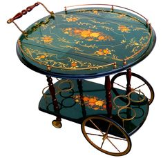 Gorgeous Italian marquetry bar carttea trolley with brass gallery wheels and bottle fittings Exquisite inlaid marquetry detail inset in deep teal wood Top tier has drop l. Serving Trolley, Tea Trolley, Drinks Trolley, Antique Tea Cart, Italian Bar, Bar Cart Styling, Coffee Carts, Coffee Uses, Deep Teal