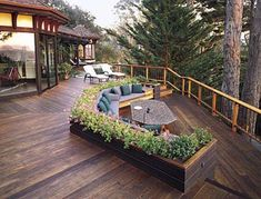 The Western red cedar decking runs in three directions, defining different areas and directing the eye outward.