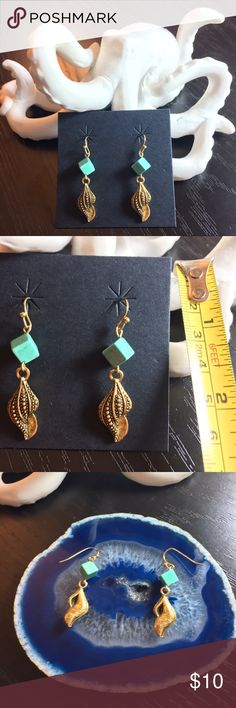 Turquoise and gold-tone seashell dangle earrings Turquoise (/dyed howlite) and gold-tone seashell dangle earrings. Never worn, perfect for summer and the beach. Mermaid style. Handmade by yours truly! New, but no tags because it is handmade. 💰Bundle to save 2️⃣5️⃣%! 💰 Handmade Jewelry Earrings