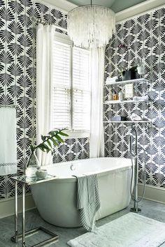 Capiz chandelier over bathtub