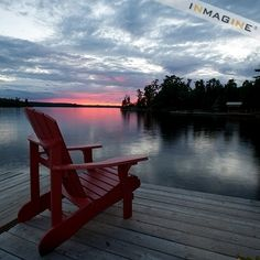Muskoka chair on the dock at sunset in Lake of the Woods,Ontario photo