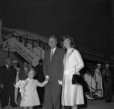 pineconepals:    Jackie beams as she is reunited with the President after her and Caroline's return from Italy.  1962