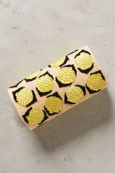 Switch it up with this straw lemon clutch that will take you from sippin' lemonade on the veranda to conquering the dance floor at a wedding reception.